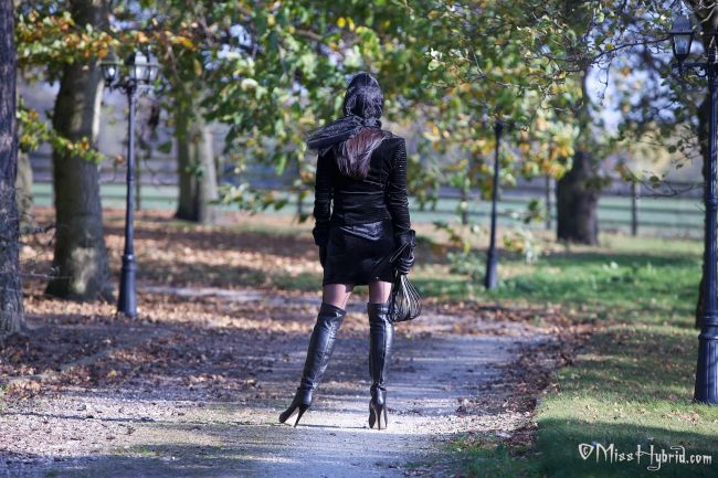 Mistress autumn in thigh high black boots dominates male 3
