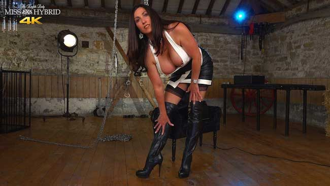 Mistress Hybrid leather boots Sybian ride with seamed stockings and leather skirt.