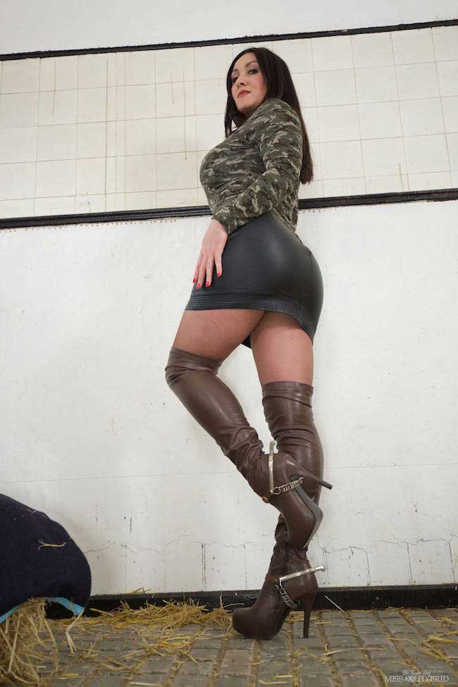 Leather thigh boots Sybian ride Miss Hybrid short skirt and spurs in the stables.