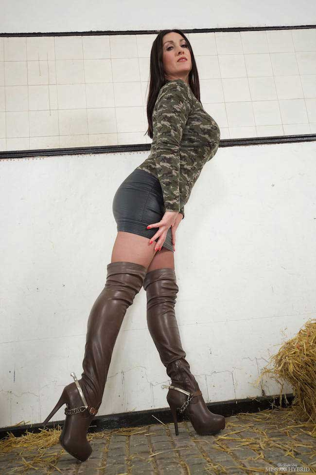 Leather thigh boots Sybian ride Miss Hybrid leather skirt and figure hugging cammo top.