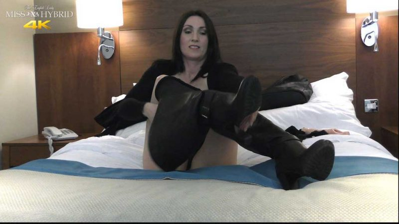Miss Hybrid sexy boots and nylon pantyhose toys her pussy on the bed.